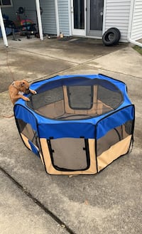 Portable kennel for cats and small breed dogs.