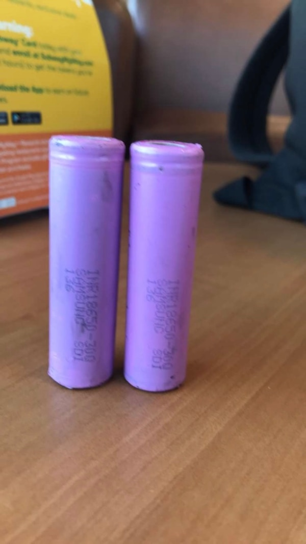 two purple and pink plastic bottles