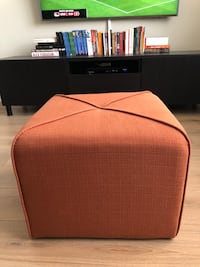 Small Red Structube Ottoman - WEBB. In perfect condition. Used it for less than a month.  Toronto, M8V 1J3