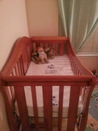 baby's brown wooden crib Washington