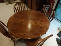 "Oak table and four chairs.  30"" (height) x 41.5"" (diameter).  All in very good condition   Woodbridge, 22192"