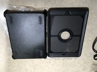 Brand New iPad 5th and 6th Gen Defender Series Case Black (SKU: 77-55876) with screen protector. Calgary, T2Y
