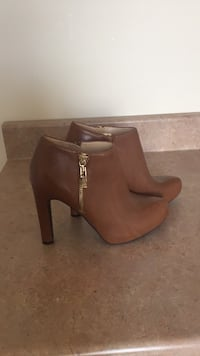 pair of brown leather heeled booties Montréal, H1E 7R6