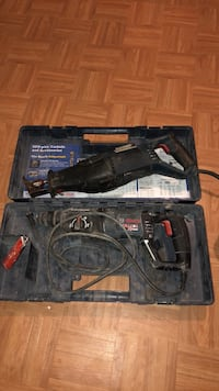 black and blue Bosch corded hammer drill with case Alexandria, 22304