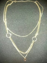 gold-colored cuban chain necklace