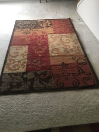 brown and red floral area rug 42 km