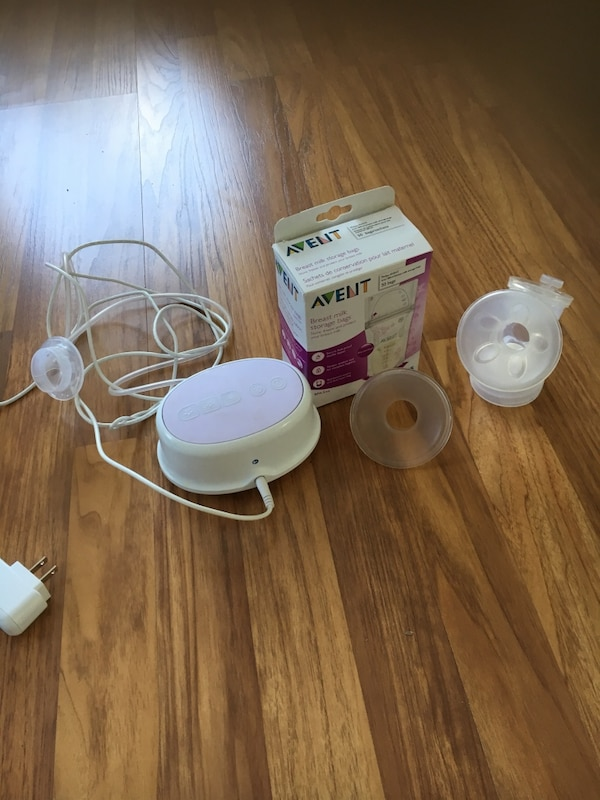 Avent breast pump hardly used plus breast milk storage bags  6d72c1cc-6fbb-410c-9590-fd1793f8fc5a