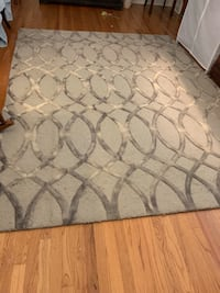 """Grey/Beige hand tufted rug, 6'11""""x8'10"""" Carpet padding included for free. If allergic to cats will need to have cleaned. Enlarge picture to see picks on rug from cat claws"""