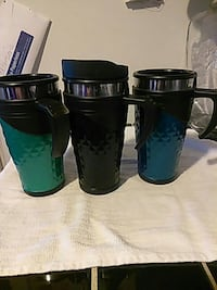 three gray-and-black tumblers