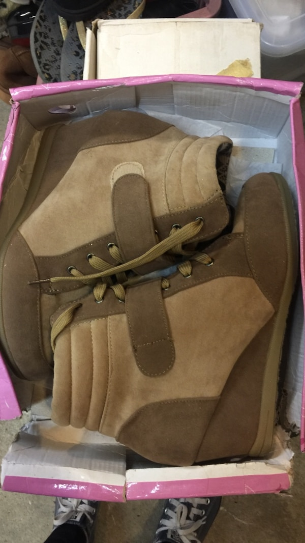 pair of brown suede boots in box