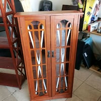 brown wooden framed glass cabinet El Paso