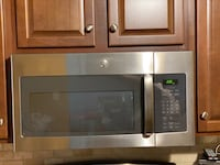 GE stainless steel over the top range microwave with exhaust fan Lutherville-Timonium, 21093