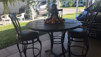 round brown wooden table with four chairs dining set New Port Richey, 34653