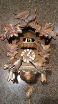 Musical Cuckoo clock with dancers