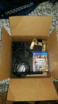 black Sony PS4 console with controller and game ca Fort Worth, 76104