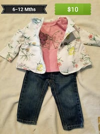 girl's white floral jacket with pink printed shirt and blue denim jeans