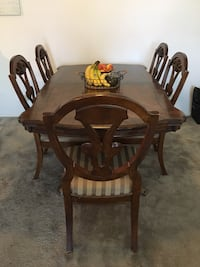 Cherry wood dining room table with 6 chairs. table has extension leaf that is 12 inches long. table is 42w by 70l. chairs do have some stains, however can be re-upholstered easily as they are very good solid wood. there are a few marks on the table as wel Carol Stream, 60188