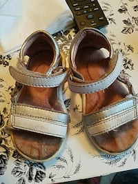 white-and-brown leather open-toe hiking sandals
