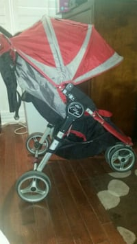 baby's black and red stroller Toronto, M6C 2P7