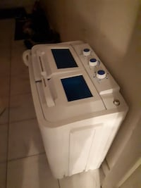 white twin-tub clothes washer and dryer