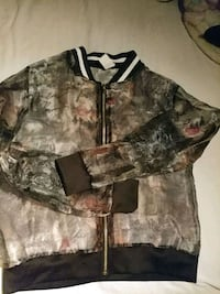 brown and black camouflage zip-up jacket Houston, 77076