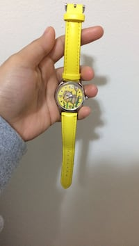 round gold analog watch with yellow leather strap