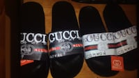 pair of black-and-white slide sandals Ottawa, K2C 3G1