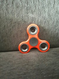 red and black fidget hand spinner