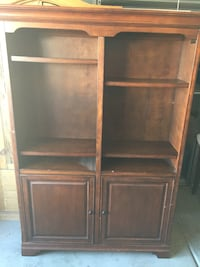 Large bookcase with doors. Heavy wood