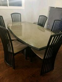 rectangular brown wooden table with six chairs dining set Toronto, M6G
