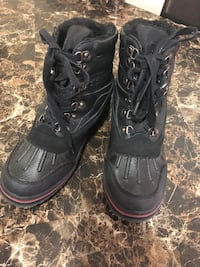 pair of black lace-up boots 3151 km