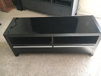 Dark brown with black glass top tv stand