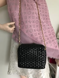Black and gold-colored link chain crossbody bag