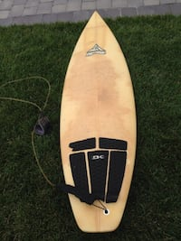 beige surfboard with black traction pad Pleasantville, 08232