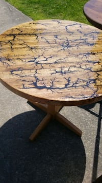 brown wooden table with black metal base Virginia Beach