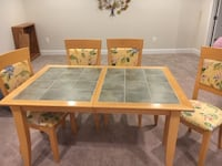 """74"""" x 37"""" wooden table with enlaid tiles and 4 matching chairs Odenton, 21113"""