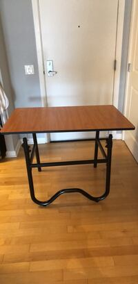 rectangular brown wooden table with black metal base Washington, 20226