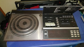 black and gray Pioneer DJ turntable with remote