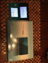 teal Nintendo 3DS with box