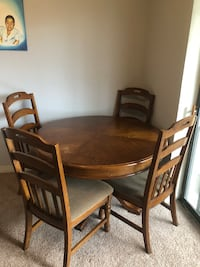 Oval brown wooden table with six chairs dining set, a coffee table, 1 end table, love seat and couch 36 mi