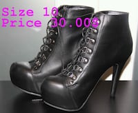 pair of black leather heeled booties Candiac