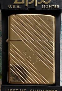 Zippo lighter, brass. Engraved with the name Jay.
