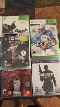 four assorted Xbox 360 game cases Fort Mc Coy, 32134