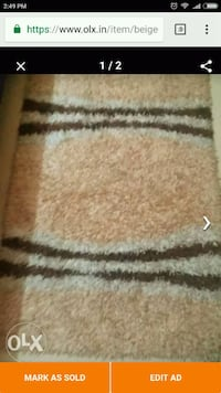 brown and white area rug Mumbai