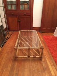 Brown wooden framed glass top table Montréal, H1Y 2N5