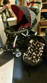 baby's black and pink travel system New Westminster, V3M