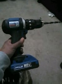 black and blue Makita cordless hand drill
