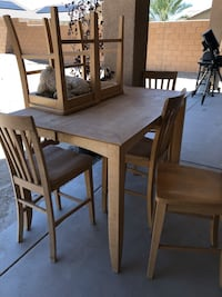 rectangular brown wooden table with four chairs dining set Indio, 92203