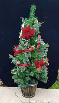 Decorative 4-ft lit artificial xmas tree. Small chip in base. Unused.  Milwaukie, 97222