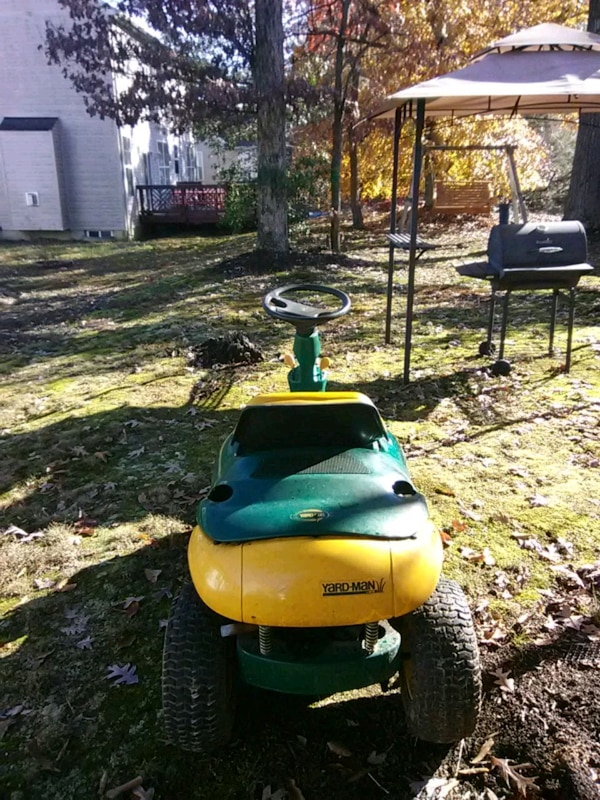 yellow and green lawn mower